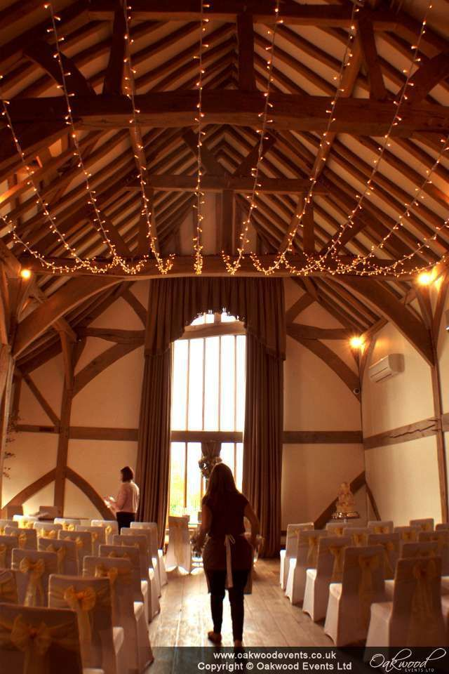 Single swag fairy light canopy for a late summer wedding at Cain Manor