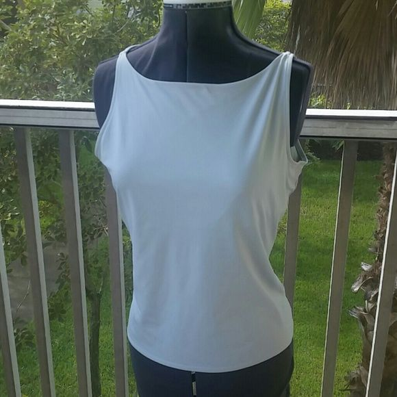 Light blue camisole with shelf bra Great under jackets nylon/spandex so has stretch Kenneth Cole Tops Camisoles