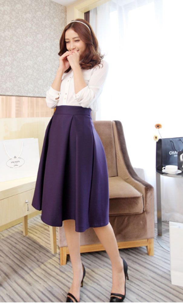 Vintage pleated midi skirts perfect for officewear in purple