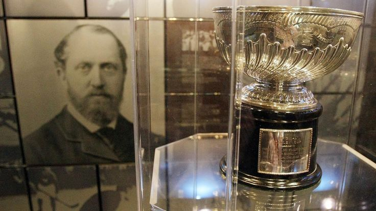 TORONTO, ON - NOVEMBER 09: The original Stanley Cup with a photo of Lord Stanley of Preston in the background in the vault at the Great Hall at the Hockey Hall of Fame on November 9, 2009 in Toronto, Canada. (Photo by Bruce Bennett/Getty Images)