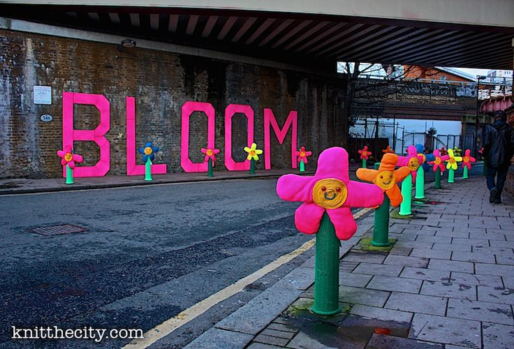 Brixton yarnstorm graffiti knitting - flowers Knitted Bollard covers