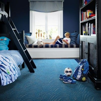 Textured carpet tile in two shades of blue, all turned the same direction looks like one large piece of carpet.
