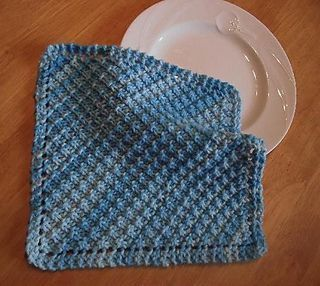 """Here's another variation of the """"traditionnal"""" garter stitch diagonal dishcloth, using what is called """"hurdle stitch"""". Makes a great baby blanket too!"""