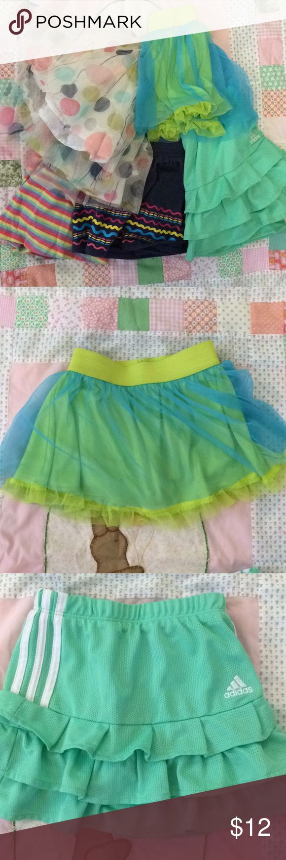 """✨ Lot of 5 skirts/skorts 4/5 and 4t. My daughter wears skirts under and over EVERYTHING! Multi-colored balloons skirt is Cherokee 4t with no observable snags. Denim colored (soft cotton) skort with multi squiggly lines is a 4/5 - tag says """"mix&match."""" Mint Adidas skort has white stripes on both sides and is 4t. Multi striped skort is 4/5 """"mix&match.""""  Aqua and lime tutu skort is My Little Pony MLP 4t - piling on undershorts and a few snags on skirt. All of these fit her at the same time. See…"""