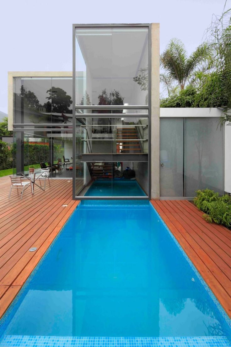 Swimming Pool. Appealing Contemporary House with Unique Pool Concepts: Appealing Contemporary Layout House Unique Pool Concepts Design House In La Planicie With Wooden Floor In Beside Swimming Pool Ideas ~ wegli