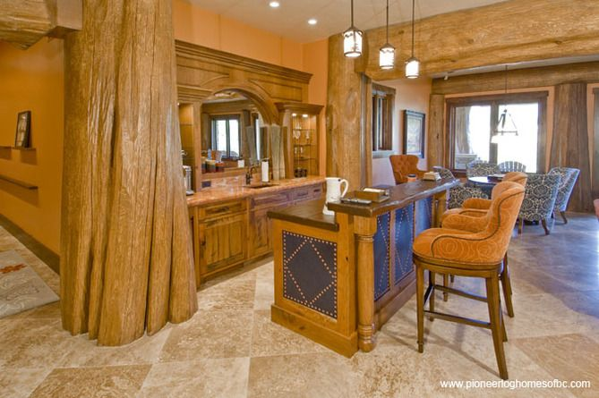 Courtesy of Pioneer Log Homes of B.C. - the SIZE of that interior support!!