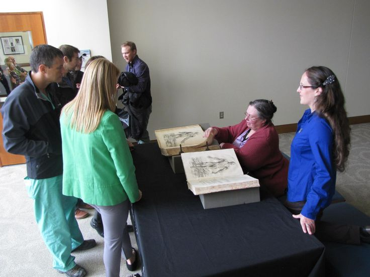 #CUHSLibrary staff expounding on features of Vesalius' De Humani Corporis Frabrica at our celebration of the 500th Anniversary of Andreas Vesalius' Birth. Event was November 19, 2014 at the CU Denver HS Library Anschutz Medical Campus.