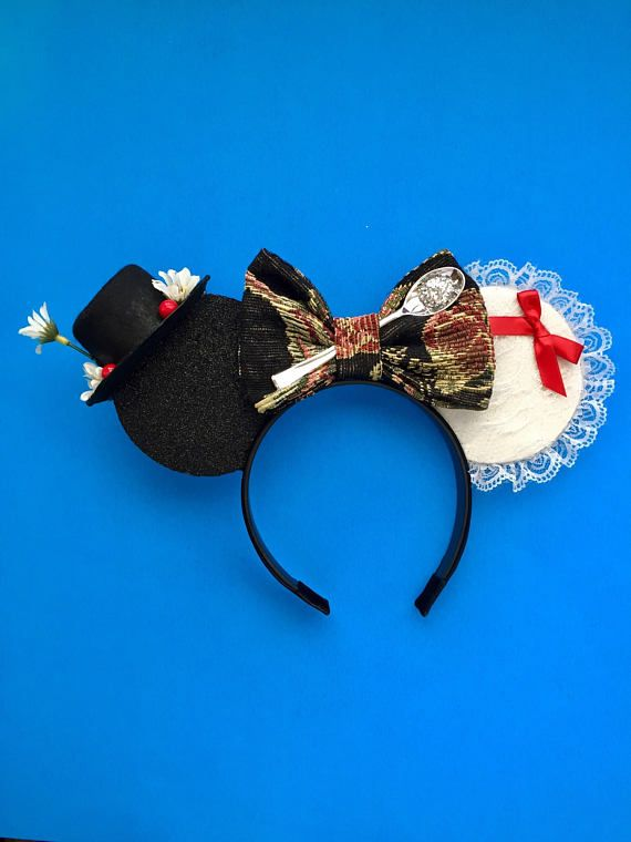 These Mary Poppins Mash up ears feature everything you love about Mary Poppins and so much more!! Ears are made from sparkle craft foam, trimmed in Sequin. Ears measure approximately 4 inches in diameter. The headband is about 3/4 in wide and 14 inches in length. Ears come with Mary