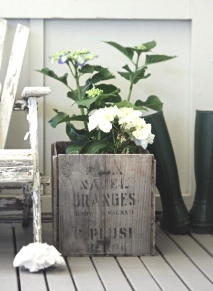 Vignette with vintage white chair and flowers displayed in old box Repinned by www.silver-and-grey.com