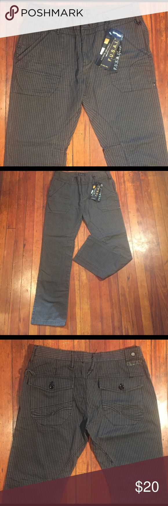 "Men's Grey Jean Style Slim Fit Hipster Pant 34x32 For your consideration is a grey plaid Jean style hipster pant Sz 34x32. (Pant is label wrong on tag and inside at waist, marked 36x34, but Actual measures taken w tape measure indicate 34x32.) Jean features nice stitching/details and are 8"" across cuff. Message with questions and thanks for stopping by. Jeans Slim"