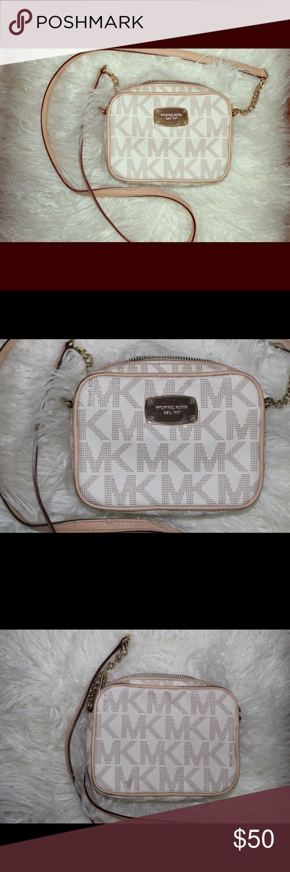Micheal Kors crossbody White and cream Micheal Kors crossbody bag.. with gold accents. ***there is makeup stains inside of bag*** Michael Kors Bags Crossbody Bags