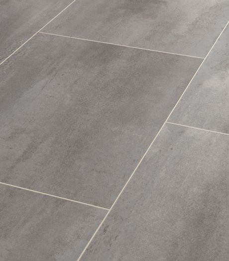Karndean Opus Urbus SP213 vinyl flooring bring a versatile mix of light and mid grey tones to this travertine inspired stone tile effect. Reflecting the trend and modern design for poured concrete, Urbus looks beautiful when coupled with a contrasting grout effect strip. The strip displayed between the tiles is AF05 3mm design strip.