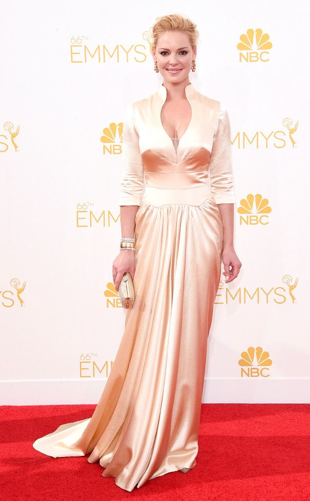 Katherine Heigl from 2014 Emmys: Worst Dressed Stars  This shade of champagne washes out the actress and the long sleeves and high neck age her a bit.