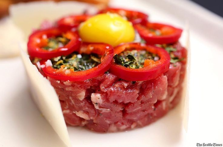 Carmine's, the Bellevue spinoff of Seattle's long-running Il Terrazzo Carmine, uncannily captures the spirit of the original restaurant, founded in 1984 by the late Carmine Smeraldo. Tartaro di manzo, Carmine's version of beef tartare, with gremolata, Fresno peppers, quail egg and pecorino. ( by @seaken1 / The Seattle Times)