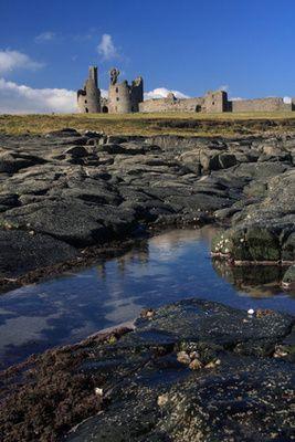 The 14th century Dunstanburgh Castle, Northumberland, UK