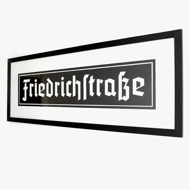 Friedrichstrasse Station underground sign, Berlin. Linocut print of 1930's, gothic, enamel underground sign. 70cm x 25cm. Black ink on white archival paper.