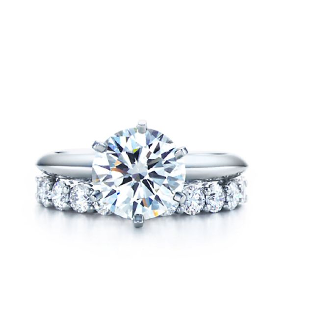 Diamond Wedding band with the Tiffany engagement ring. This would be the most perfect ring