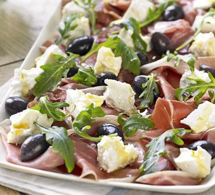 Serrano ham, olive, feta & rocket platter with homemade crostini. Serve this help-yourself platter while you get on with the rest of supper. In summer, add a few sliced fresh figs