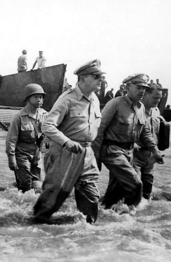 General Douglas MacArthur wades ashore at Palo, the Phillipines, 20 October 1944, fulfilling his promise to return