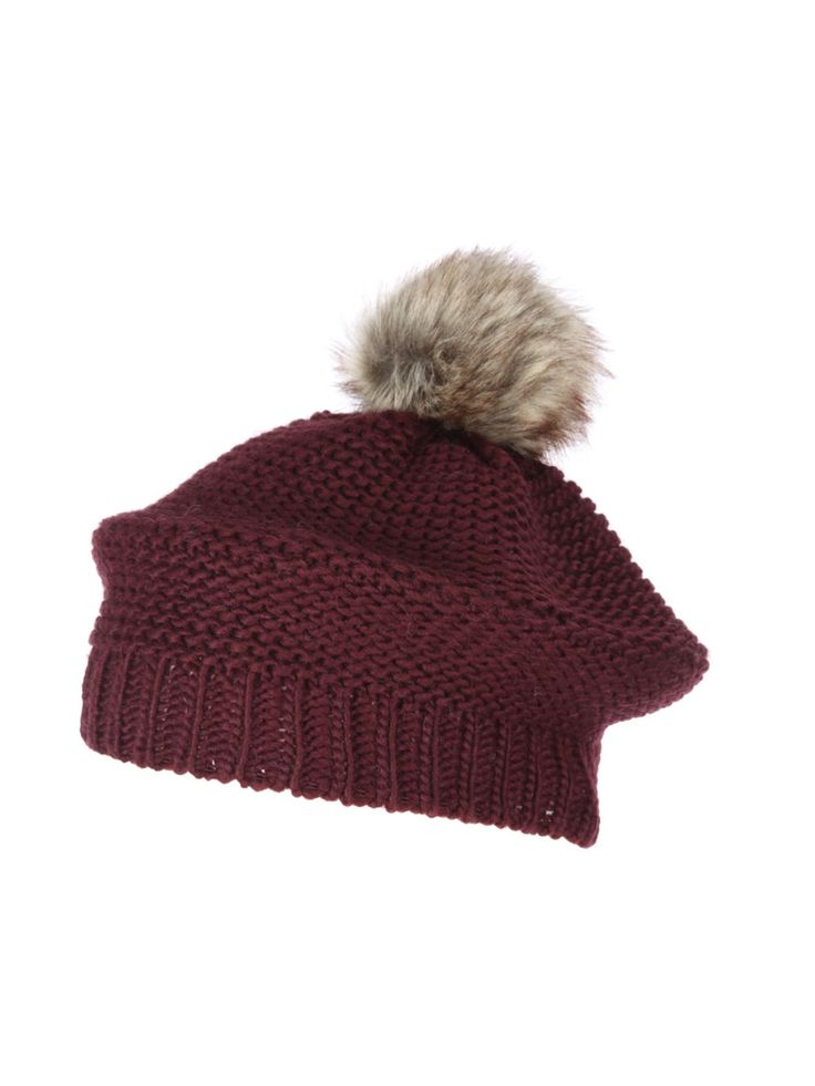 Look stylish in the cold with this on-trend beret. In a gorgeous red wine hue featuring a knitted design with a fun pom pom, it's perfect for keeping warm an...