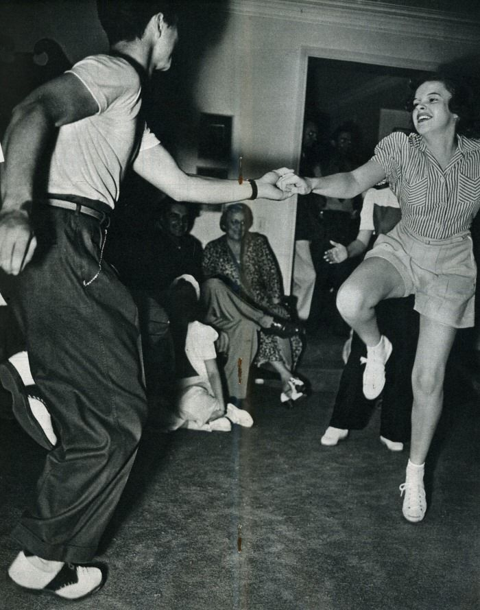 Judy Garland dancing the jitterbug with champion dancer Ray Hirsch at a party Judy and Mickey Rooney threw to celebrate a recent movie (1940).