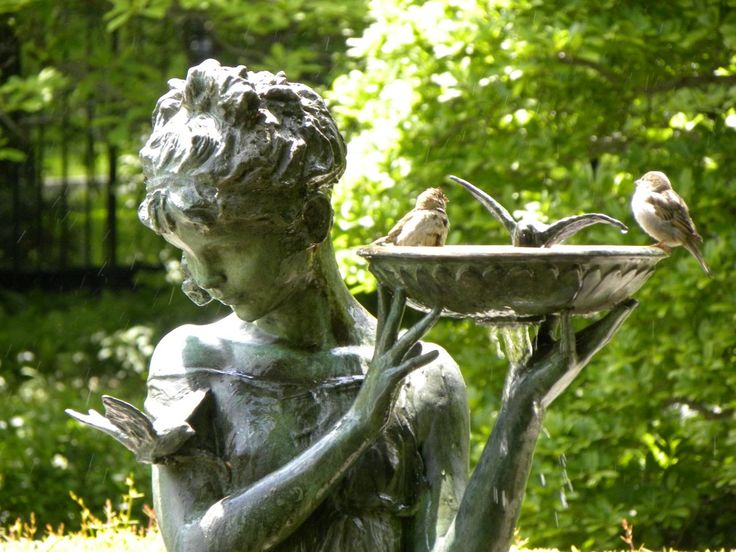 The Secret Garden. Burnett Fountain Conservatory Garden, New York. This statuary fountain stands in the center of the Conservatory Garden's South Garden, a memorial tribute to Frances Hodgson Burnett, author of the children's classics The Secret Garden (1909).