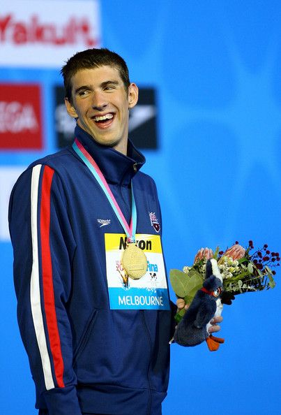 Michael Phelps Photos Photos - Michael Phelps of the USA poses with his gold medal following his victory and new world record in the Men's 200m Individual Medley Final during the XII FINA World Championships at the Rod Laver Arena on March 29, 2007 in Melbourne, Australia. - XII FINA World Championships - Day 13