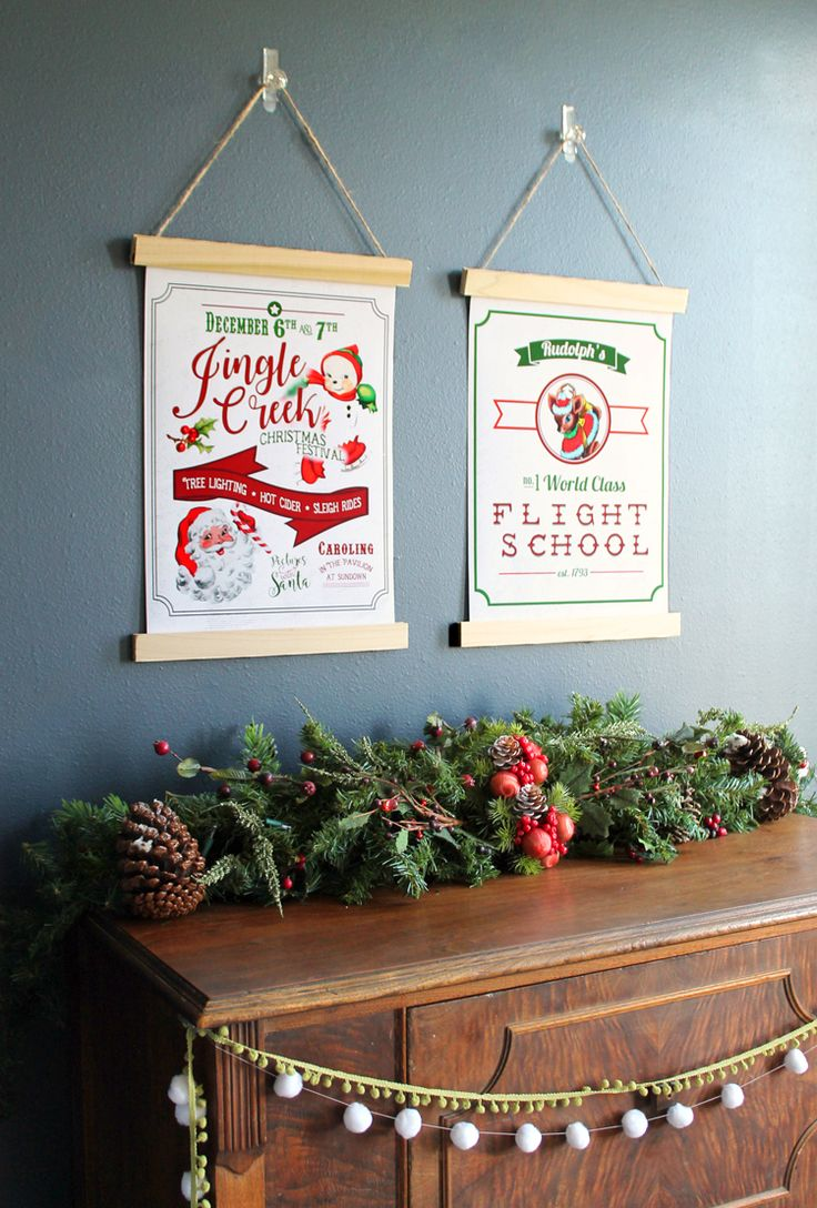 Free printable Christmas wall art that looks like a pair of vintage posters. DIY holiday decor that's simple to make.