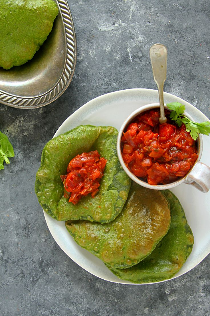 Palak Puri & Quick Tomato Chutney -- Puris or pooris are deep-fried whole-wheat breads commonly eaten for breakfast or dinner in Indian households. Kids especially love puris because they puff up beautifully with a crisp exterior. Paired with a simple vegetable chutney or curry, it makes for a delicious, wholesome meal.