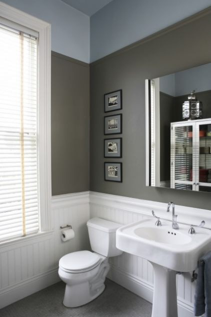 Light blue and olive small bathroom with bright white wainscotting
