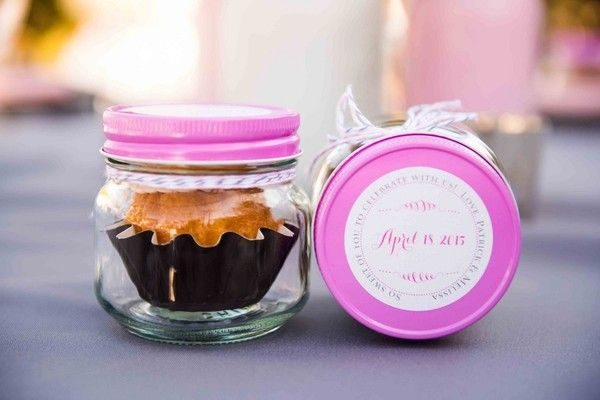 Mini cupcake wedding favors in glass jars {Brett Charles Rose Photography}