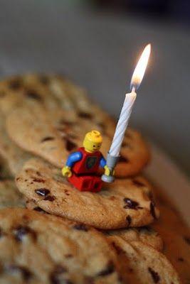 Lego guy holding the birthday candle