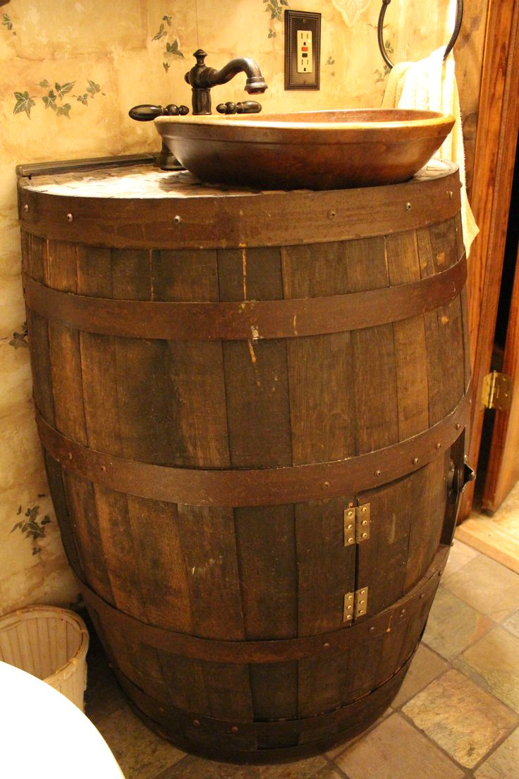 Bathroom Decorating. We took an old wine barrel and old wooden bowl and made it our vanity in our little bathroom.