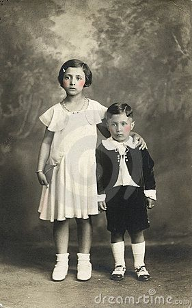 Taken in Italy probably in 1910. Cute kids in their Sunday's clothes. Black and white photo with a touch of pink.