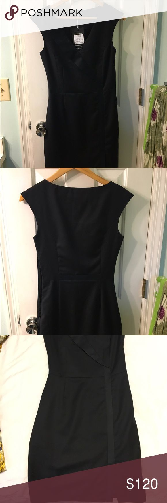 Navy blue dress 100% wool professional dress with slight front slit. Purchased from online boutique but the bust was a tad small (my size is 34C). New with tags, only tried on--never worn. dress & code Dresses