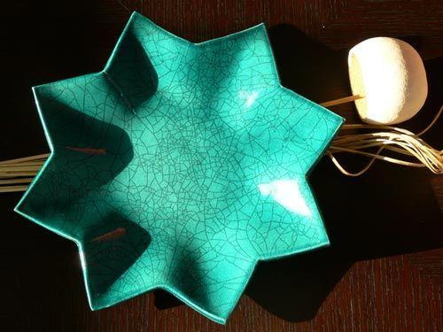 Piatto raku a forma di stella verde bottiglia - NonSoloRaku.net