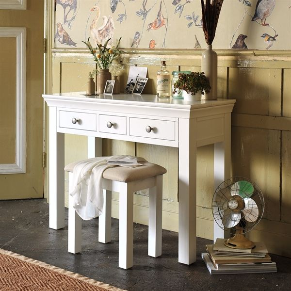 Chantilly Dressing Table from The Cotswold Company. Free Delivery & Free Returns    White Painted Dressing Table styled in a country bedroom with birds wallpaper and vintage photographs.