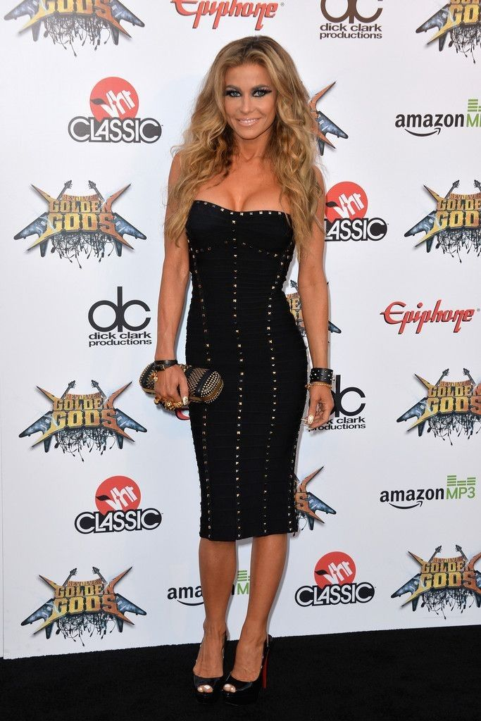 Carmen Electra.. Herve Leger Studded Strapless Dress, Christian Louboutin Lady Peep Slings, and Alexander McQueen Studded Leather Knucklebox Clutch..... - Celebrity Fashion Trends