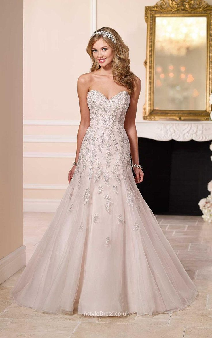 A simply spectacular fit and flare wedding dress for a bride who wants to be remembered on her big day, this lace and tulle bridal gown features sparkling Diamante beading on its fitted bodice and an ethereal train.