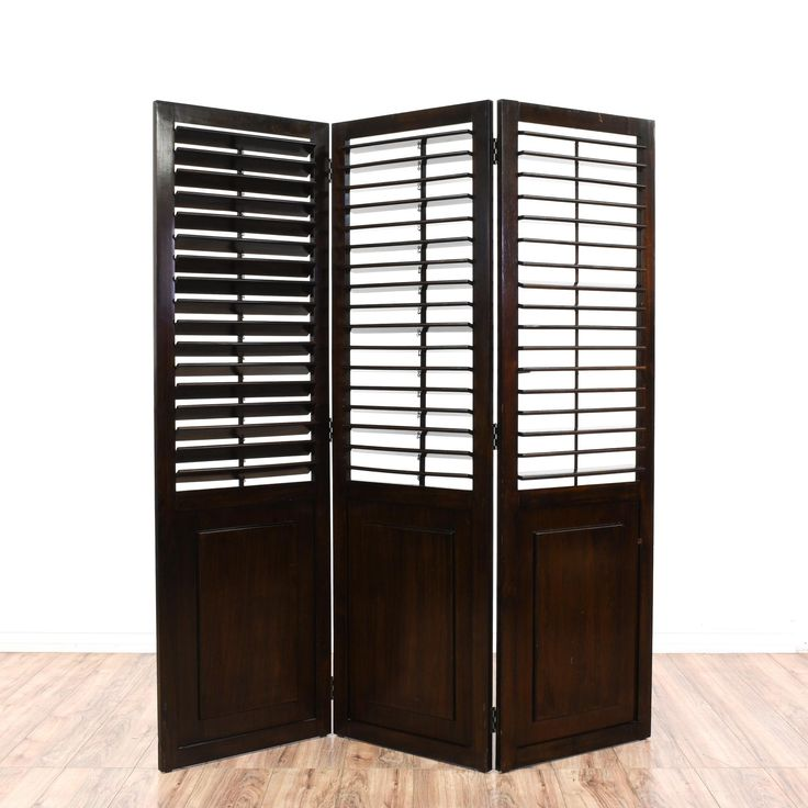 This folding room divider is featured in a solid wood with a glossy dark espresso black finish. This country chic room screen has 3 folding panels with top shutter blinds that open and adjust. Perfect for separating a space and letting in light! #countryfarmhouse #decor #wallart #sandiegovintage #vintagefurniture