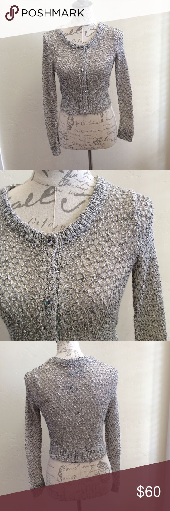 Alice + Olivia Silver Cardigan This silver Alice + Olivia button up Cardigan is perfect to add a little sparkle to your holiday wardrobe. It is waist length and features rhinestone buttons. So cute! Size S Alice + Olivia Sweaters Cardigans