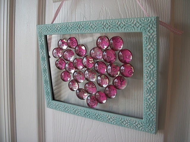 Super cute frame, paper, and bead craft. -  would be cool with bottle cap pictures (like the bottle cap picture magnets DIY) in a heart shape