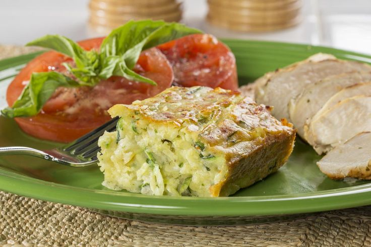 When you serve zucchini this way, even the pickiest of eaters will be asking for seconds of their veggies. Our recipe for Zucchini Squares is a baked zucchini dish that's made with grated cheese, lots of seasonings, and a few other ingredients. It's