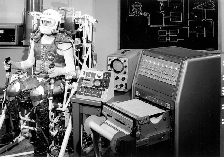 A pilot restrain and Closed Loop Breathing System, 30 November 1962, public domain via Wikimedia Commons.