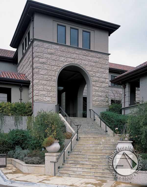 Cast Stone elements including the rustic stone face, stair tread and planters.