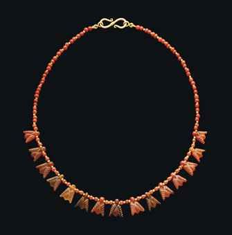 AN EGYPTIAN CARNELIAN FLY PENDANT NECKLACE  NEW KINGDOM, CIRCA 1550-1250 B.C.  Composed of fifteen fly pendants with detailed wing cases strung between spherical carnelian and gold spacer beads, restrung with modern hook and loop closure.