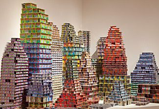 "Jean Shin transforms castoff materials into monumental installations that convey expressions of identity and community.  Shown is Chance City, made from discarded ""Scratch & Win"" losing lottery tickets."