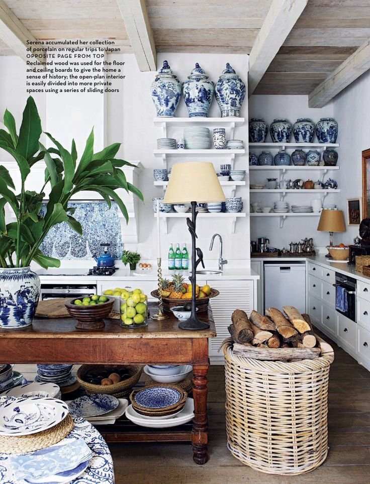 Reclaimed wood on floor and ceilings give a sense of history with blue and white accumulated collection of porcelain and baskets traveling to an island vibe Serena Crawford