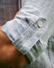 This sleeve tab detail = the perfect way to dress down a button-up shirt!