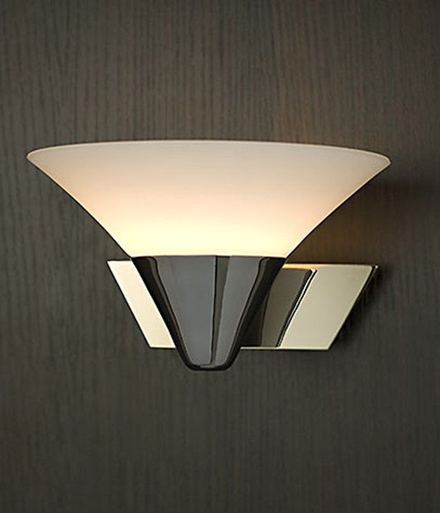 This indoor wall lamp designed in Australia is made from polished stainless steel with opal matt glass with a IP rating of 44 (great for use in bathrooms)